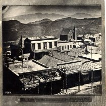 Image of UNRS-P1987-27-06 - Photograph of Maguire's Opera House, taken from the International Hotel Virginia. Caption on image: 715. View from the International Hotel, Virginia City, Nevada.  Handwritten on verso: View of Maguire's Opera House.  Virginia City, Nevada.  Opened July 2, 1863, with Buliver's Money.  Julia Dean Hayne, Frank Mayo, Junius B. Booth, Jr. & Walter M. Leman in company.  The latter wrote the dedicatory ode.  Purchased from Newbegin's Book Store 7/23/46.