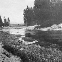 Image of UNRS-P2008-18-4003 - Truckee-Carson Project. May 9, 1916. Showing absence of snow except in isolated patches, near Lake Tahoe. Looking up Truckee River. Outlet dam and bridge in background.