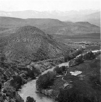 Image of UNRS-P0078-12 - Truckee River and irrigating ditches. Desert mountains on one side, alfalfa fields on the other. Sierra in the distance. Photo by Laura S. Doten. [Ca. 1910-1920] From the George Wharton James collection