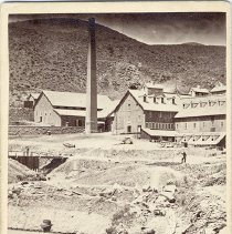 Image of UNRS-P0138-4 - Photograph of Bonner Shaft, Gould and Curry Mine. Caption on image: Sacking the Tailings--Gould & Curry Mill. 1864 or 1865. Photo by Lawrence & Houseworth.