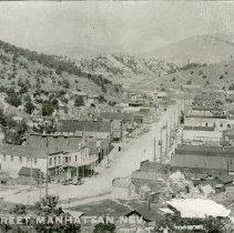 Image of UNRS-P2012-10-229 - Caption on image: Main Street Manhattan, Nevada.