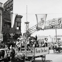 Image of UNRS-P2012-10-284 - [Parade on Virginia St. showing Reno Arch and Reno Sky Ranch float.]