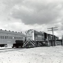 Image of UNRS-P1987-23-3216 - Southern Pacific. Engine 5230 picking up a couple of bull crates at Wabuska, forty miles south of Hazen. Coach is standing on the main line. 2-12-51.
