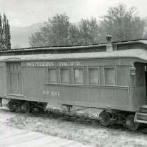 Image of UNRS-P1987-23-3409 - Southern Pacific. Two views of combine used as a caboose; at left, at Laws and at Owenyo with standard gauge cons in the background.