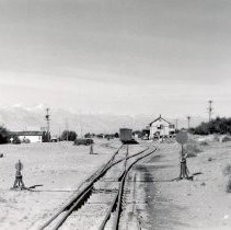 Image of UNRS-P1987-23-3433 - Southern Pacific. The yard at Keeler from the south with the depot at right and the town at left. 10-31-50.