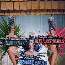 """Image of UNRS-P1992-03-0376 - Vive les Girls at Nevada Lodge. Three woman are holding signs and are dressed in sparkled costumes and hats. Caption on image: Staged and Choreographed By Ron Lewis. Costumes Designed By Jose Luis Vinas. Concieved, Produced, and Directed by Frederic Apcar. Caption on verso: Frederic Apcar's Vive Les Girls at Nevada Lodge! The """"must see"""" Parisian revnue, summertime feater in the Topaz Room of the Nevada Lodge. . . North Lake Tahoe's largest year 'round resort - hotel - casino."""