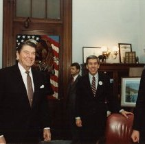 Image of UNRS-P2015-12-00044 - President Reagan with Vice President George H. W. Bush, and Indiana Senator Richard Lugar outside Laxalt's office.  All the men in the photo are wearing Reagan-Bush '84 campaign buttons.