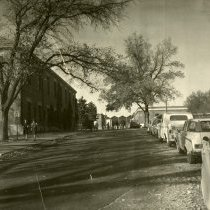 Image of UNRA-P1075-12 - Campus path next to parking lot, with Getchell Library in the background (1960s)