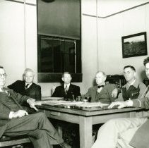 Image of UNRA-P156-38 - Faculty Committee: President Leon Hartman, Dean Frederick Wood, Dean Fred Traner, Frederick Sibley, Dr. J. A. Carpenter, Professor A. L. Higginbotham, and Colonel Oral E. Clark (1941)