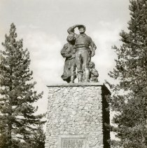 Image of UNRS-P1992-01-2777 - Statue of the Donner Party at Donner Lake. Caption on image: Monument created to members of the ill-fated Donner Party who perished in winter of 1846-1847. Zan 926. Nevada Photo Service.