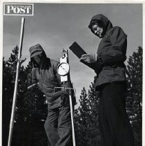 Image of UNRS-P2004-18-323 - Saturday Evening Post photograph featuring James Church and an unidentified woman with snow measuting equipment. Article appeared in Saturday Evening Post on January 28, 1950, Vol. 222 Issue 31, p25-93. Stamped on verso: This photograph is owned by the Saturday Evening Post...not to be reproduced in any form with the written permission of the Saturday Evening Post.