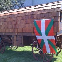 Image of bsqpd2010-001-0064 - Wooden Sheepherders wagon with Basque flag at Jaialdi