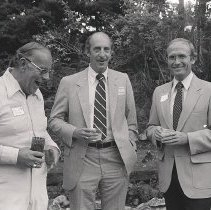 Image of UNRA-P1408-27 - Photograph of alumnus Rollan Melton, President Joe Crowley, and an unidentified man. Melton was inducted into the Nevada Writers Hall of Fame in 2001. (circa 1980)
