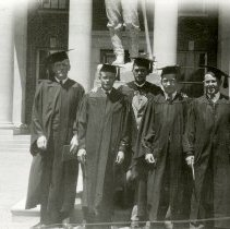 Image of UNRA-P601-1 - Mackay School of Mines, five graduates, with the building's columns and part of the Mackay Statue in the background: Robert Adamson, Norman Ericson, Paul Gemmill, Harold Vaughan (May 15, 1930)