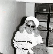 Image of UNRA-P1681-182 - Manzanita Hall resident Dani taking the stairs in winter. Page 265 of the 1987 yearbook. Photographer: Mike Hugo