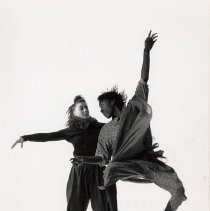 Image of UNRA-P3359-610-00003 - Photograph of two unidentified dance students, in mid-air.  (Health Ecology Department).