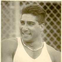 Image of UNRA-P3359-704-00003 - Photograph of Reno High School graduate Kamy Keshmiri, who won three consecutive NCAA championships in the discus from 1990-1992, setting the collegiate record of 232 feet in 1992.