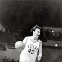 Image of UNRA-P3359-722-00001 - Photograph of Women's Wolf Pack Basketball team player Chris Starr, no. 42, on the court with the ball. She was Nevada's all-time leading scorer in 1986, establishing a new record - male or female - with 2,356 points. She was named an Academic All-American.