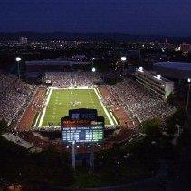 Image of UNRA-P3387-0011 - Mackay Stadium is shown in this aerial photograph during the first night game in 2003. This photograph was taken from the north looking towards downtown Reno.