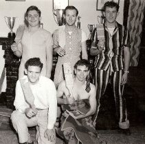 Image of UNRA-P3427-0125 - 5 unidentified students holding trophies and paddles (1941)