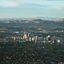 Image of UNRA-P3429-0159 - Aerial looking north: Downtown Reno and mountains