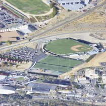 Image of UNRA-P3483-36 - Aerial of William Peccole Park and the football practice field, with Evans Avenue in the background. Viewed from the west. (September 2003)