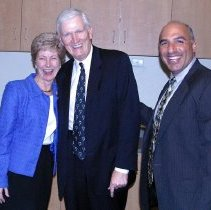 Image of UNRA-P3506-23 - Nevada System of Higher Education Chancellor Jane Nichols with President John Lilley and an unidentified man. Caption: Post Game Cheer (March 24, 2004)