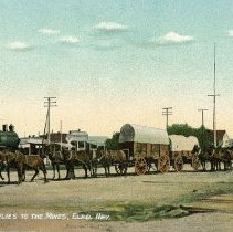 Image of UNRS-P2017-01-00009 - Horse and wagon teams. Caption on image: Hauling supplies to the mines, Elko, Nevada. Handwritten on verso: Arthur, Nevada. Aug 12 - 09. Dear Friends, Will try and get some more views of Elko to send you next time. Mrs. Woodhouse.