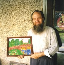 Image of Isaac Clarence Kulp with one of his folk art watercolors