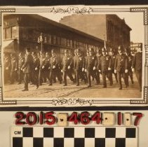 Image of 2015.464.1.7 - A photograph of policemen in marching formation