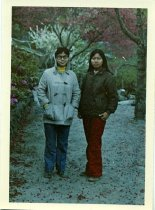 Image of Shuk Hun standing in a park with another woman, ca. 1971