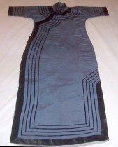 Image of Women's blue dress with black hem