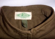Image of Green buttoned uniform coat (label)