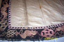 Image of Ivory robe with black embroidery trim (detail)