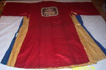 Image of Red robe with dark blue flag (back)