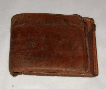 Image of A tan leather wallet