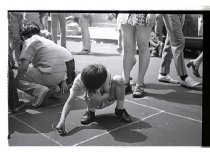 Image of A child drawing with chalk on the street, 1972