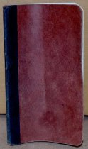 Image of A small red-brown notebook with black binding.
