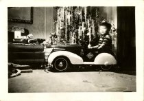 Image of Little boy in a toy car