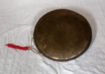 Image of Gong with twine and ribbon handle