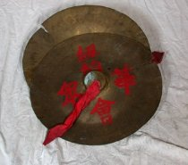Image of Two cymbals with red Chinese characters