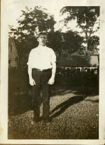 Image of Man standing on a lawn
