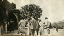 Image of Laura Turner standing with a group in front a newstand, 1928-1930