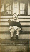 Image of Robert Ross Turner sitting on porch steps, 1932