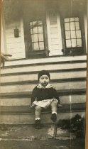 Image of Robert Ross Turner sitting on porch steps, circa 1932