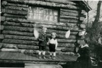 Image of Carlin Boys on the Side Porch of the Log Cabin  1919 - 1992.1.8