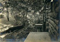 Image of Log Cabin Porch and Brook  1909 - 2004.1.349