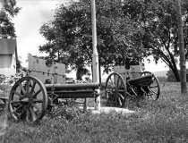 Image of Two Cannons near Unidentified Barn  1920 - 2011.6.140