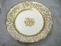 """Image of Salad Plate 7 1/4""""  1887 - White salad plates with gold highlights in a birch tree pattern.  Quantity 12.  Part of china luncheon set made by Haviland for J. E. Caldwell of Philadelphia.  Pattern: SCHLEIGER 10-1 by HAVILAND [H SCH10-1]  Description: H&CO,BLANK 10 WITH GOLD ACCENTS"""