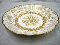 Image of Teacup Saucer  1887 - White and gold china cup saucer with gold highlights in a birch pattern.  Quantity 11. Excellent  Part of china luncheon set made by Haviland for J. E. Caldwell of Philadelphia.  Pattern: SCHLEIGER 10-1 by HAVILAND [H SCH10-1]  Description: H&CO,BLANK 10 WITH GOLD ACCENTS